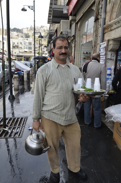 man selling tea in the streets of Amman
