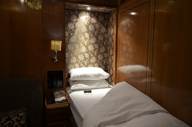 A single bed in a deluxe suite on the Blue Train