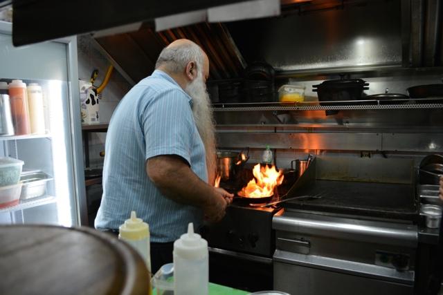 Uri Jeremias Buri in his restaurant cooking