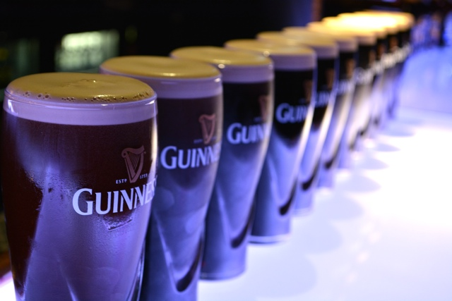 a row of guinness at the guinness storehouse - how to pour the perfect pint of guinness