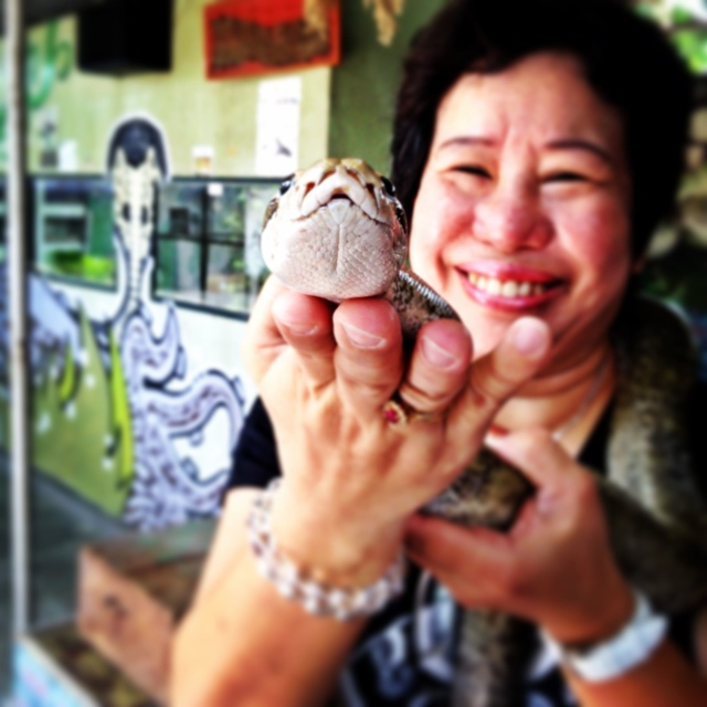 a snake lady and granite snake at the penang snake temple and farm - Malaysia As Seen Through Instagram Photos