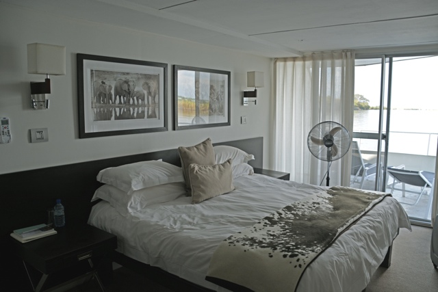 master suite bedroom on the Zambezi Queen Houseboat - staying aboard the Zambezi Queen