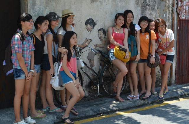 little children on a bicycle - cultural girls and cailin - The Street Art of George Town, Penang, Malaysia