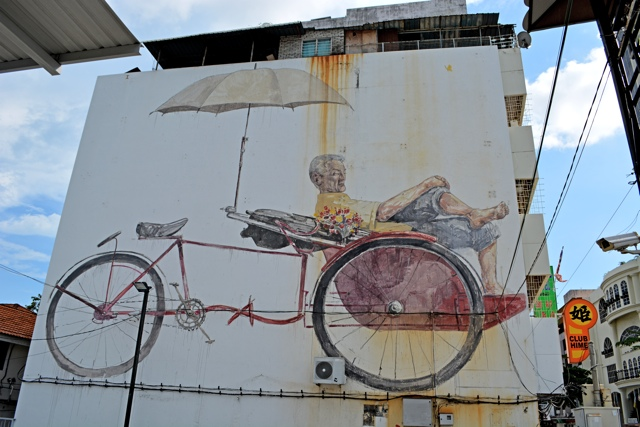 the awaiting trishaw and paddler rickshaw - - The Street Art of George Town, Penang, Malaysia