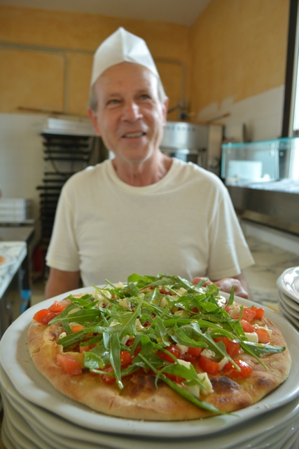Italian pizza chef with a traditional margherita italian flag pizza - 5 Best Things to do in Gargano, Italy