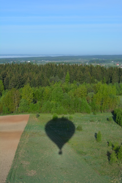 floating over a farmers field in Lithuania - Hot Air Ballooning For the First Time