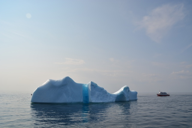 large iceberg, small boat on tour with iceberg quest in twillingate, newfoundland - Seeing Icebergs in Newfoundland