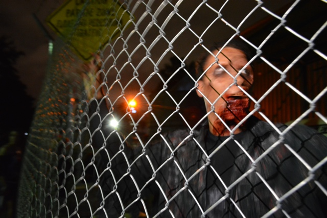 A zombie from the Walking Dead Haunted House - Halloween Horror Nights at Universal Orlando Resorts