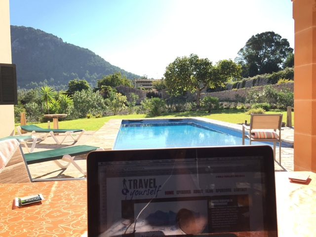 working by the pool - Staying in a Luxury Villa with Travelopo in Mallorca, Spain
