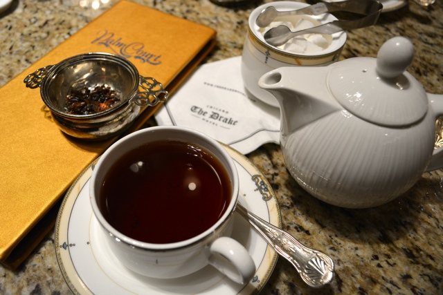 tea and menu in the Palm Court at the Drake Hotel - Afternoon Tea at The Drake Hotel in Chicago