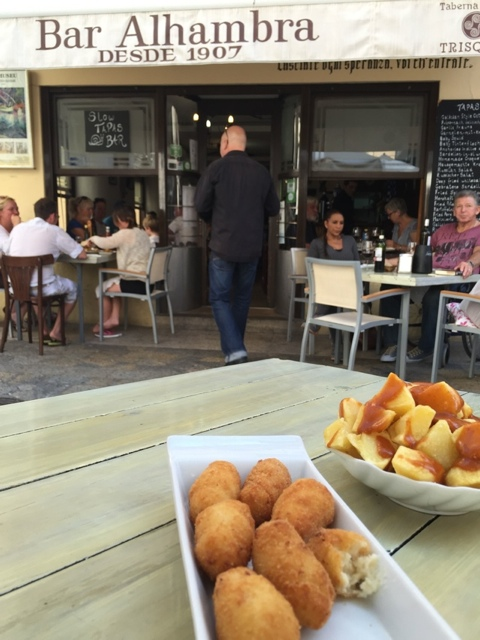 Spanish tapas at bar Alhambra in Pollenca, patas bravas and croquette - Visiting the small town of Pollensa on the island of Mallorca, Spain