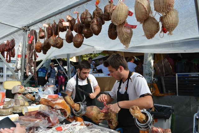 Sunday morning farmers market in Pollenca, freshly shaved jamon iberco - Visiting the small town of Pollensa on the island of Mallorca, Spain