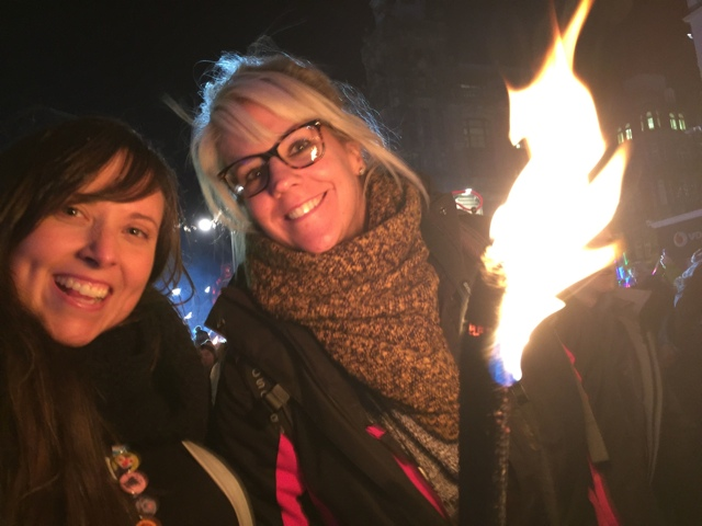 cailin and vicky flipflop at the torchlight procession - Hogmanay New Years Eve Celebrations in Edinburgh, Scotland