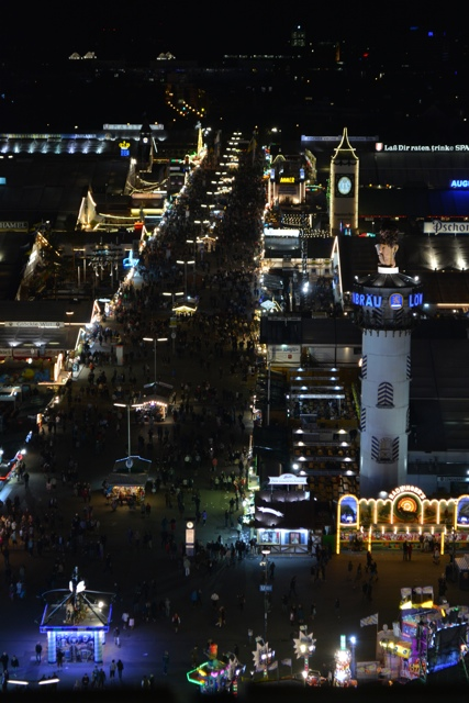 a view of Oktoberfest at night from the top of the ferris wheel - Best Tips for Celebrating Oktoberfest in Munich