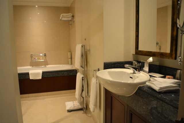 bathroom sink and tub - Cheval Gloucester Park Luxury Apartments London