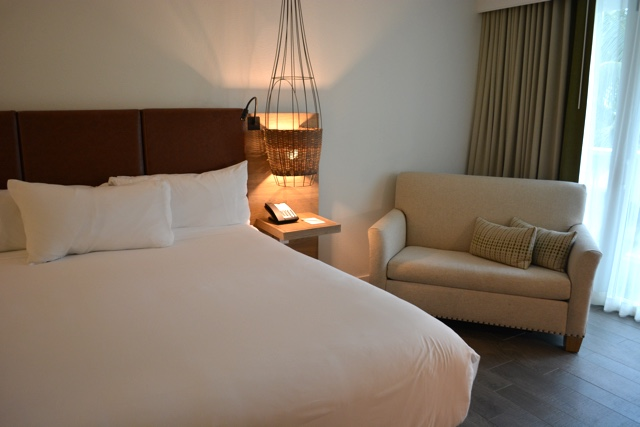 comfy bed, seating area, fish nets traps lights - Amara Cay Resort Review in the Florida Keys