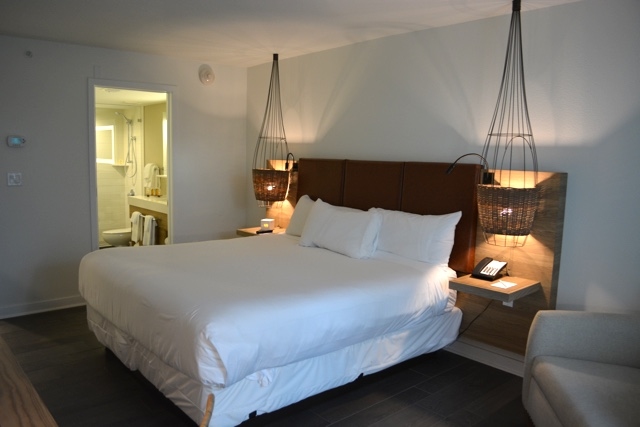 comfy double bed, fishing trap lights, bathroom - Amara Cay Resort Review in the Florida Keys