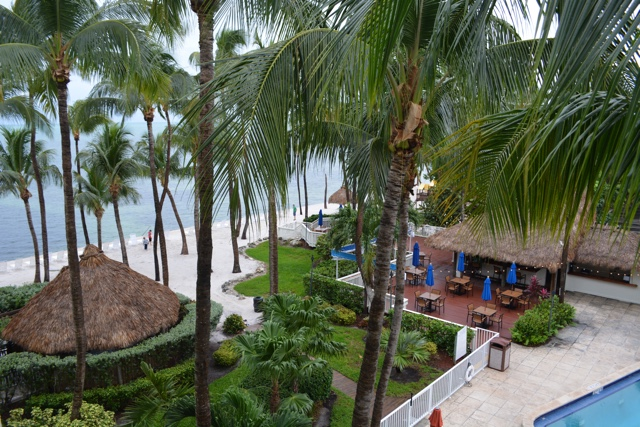 room with a view over the pool, beach and ocean - Amara Cay Resort Review in the Florida Keys