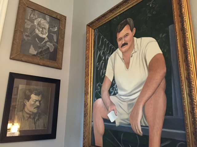 various portraits of Ernert Hemingway, cute in his younger years - Ernest Hemingway's Cats - the best part of the Florida Keys?
