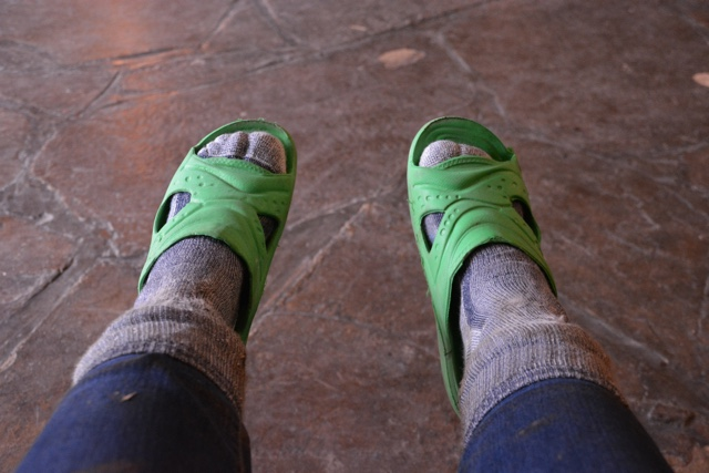 funky sandals to replace my muddy boots after trekking to see wild mountain gorillas - Trekking to see Wild Mountain Gorillas in Rwanda