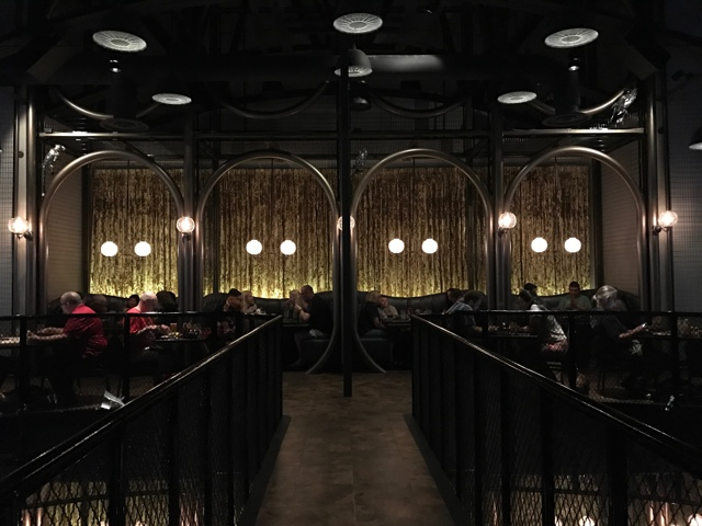 the restaurant has high ceilings and an elegant steampunk design - A Review of The Toothsome Chocolate Emporium at Universal Orlando