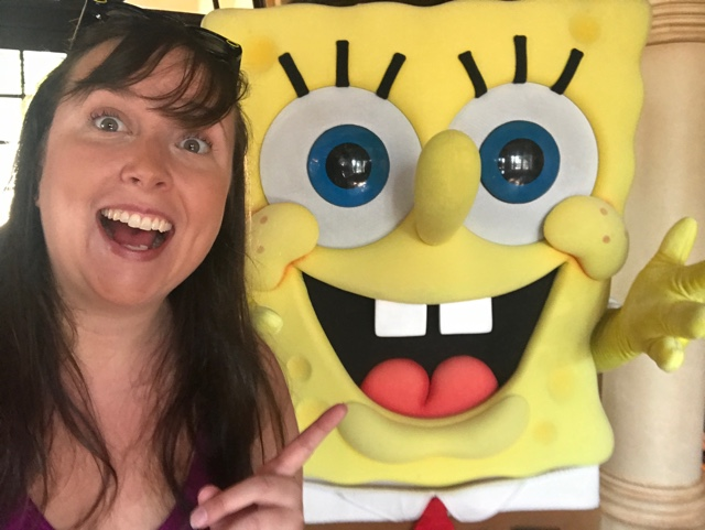 cailin with spongebob squarepants at a Universal Orlando character breakfast - Universal Orlando's Best Theme Park Foods