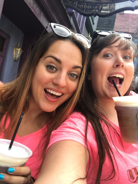 kate and cailin drinking frozen butterbeer in Universal Orlando's Harry Potter diagon alley - Universal Orlando's Best Theme Park Foods