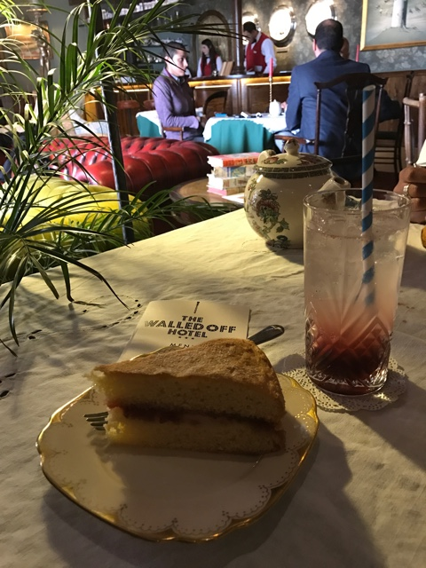 cake and a mocktail drink at Banksy's Walled off Hotel in Palestine, Bethlehem - How to Get to Banksy's Walled Off Hotel