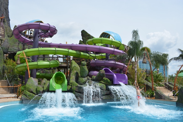 a guy goes flying out of the ohno waterslide and volcano bay - Ultimate Guide to Relaxing at Universal's Volcano Bay