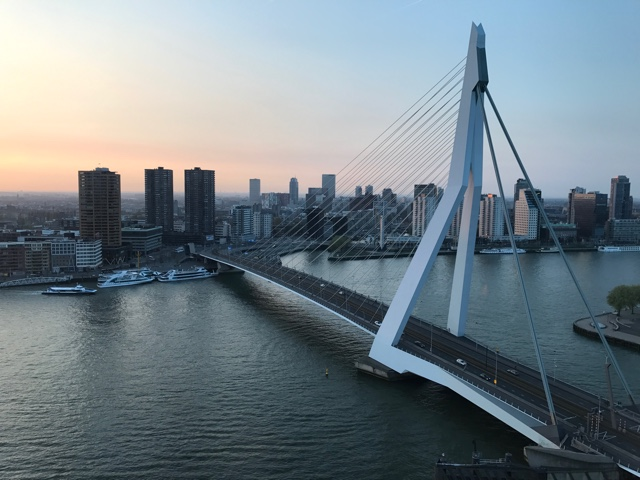 sunset from the Nhow hotel rotterdam over looking the city and Erasmusbrug bridge - First-Timers Guide for Visiting Rotterdam