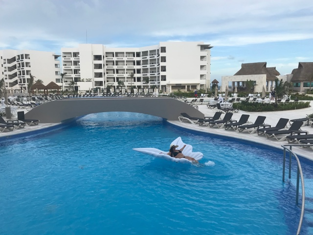 being an angel floating in the large main pool at Ventus - Ventus at Marina El Cid Hotel Review