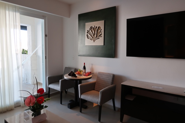 dining area with large screen tv - Ventus at Marina El Cid Spa and Beach Resort Hotel Review