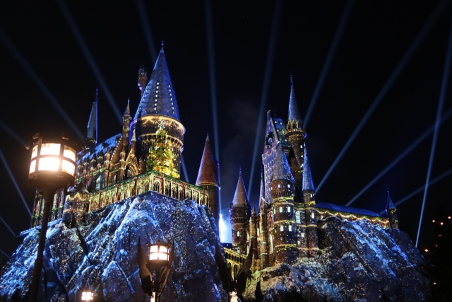 the magic of christmas at hogwarts light mapping projection show Harry Potter - Best Tips for Celebrating the Holidays at Universal Orlando