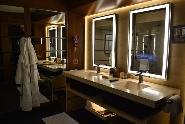 bathroom with mood lighting and tv in mirror - Four Seasons Resort Lanai in Hawaii Review