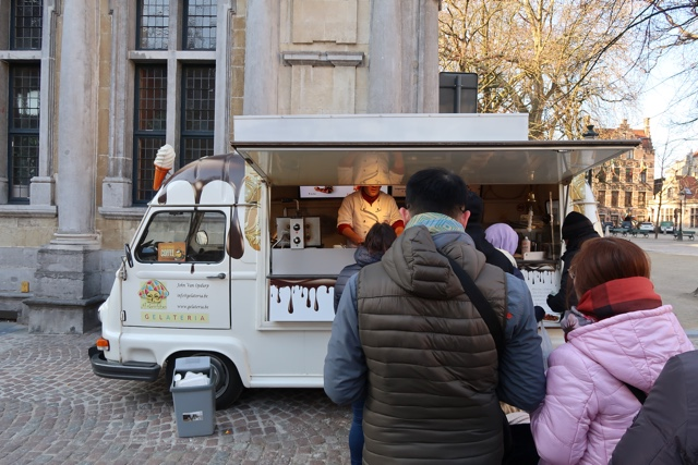 the popular Arlecchino Gelateria in Burg square Bruges Belgium with the best leige waffles in all of bruges