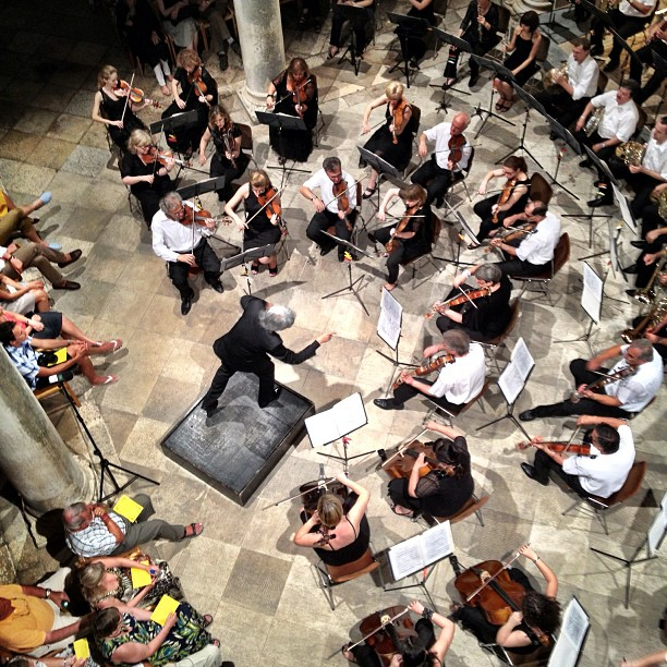 Conductor Noorman Widjaja conducts the Dubrovnik Symphony Orchestra in Dubrovnik, Croatia at the Rector's Palace Atrium