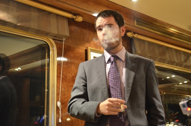 Mike from Vagabondish enjoys a Cuban cigar aboard the Blue Train in South Africa
