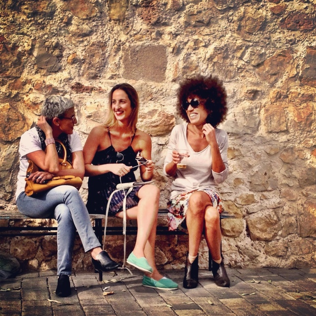 Local girls hangout at a market in Tel Aviv, Israel