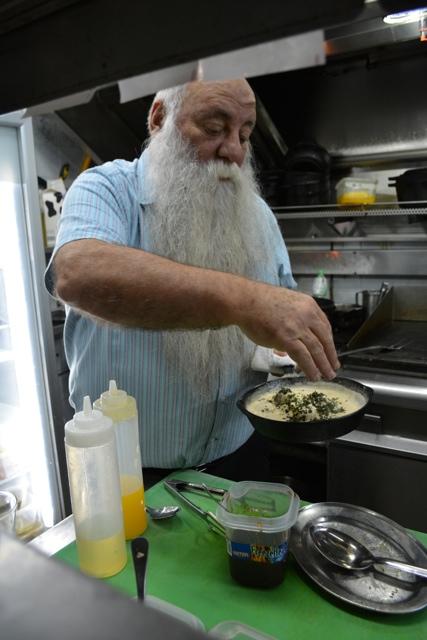 Uri Jeremias Buri in his restaurant cooking scallops