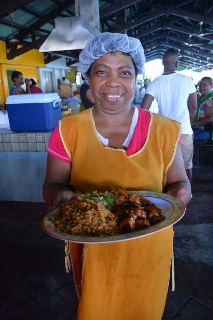 lady serves fresh local food at Plasa : Plaza Bieu Willemstad, Curacao - Best Things to do in Curacao