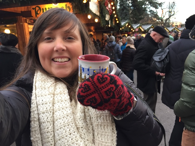 Cailin drinking gluwhein at the Vienna, Austria Christmas market - A Viking River Cruise on the Danube Through Europe