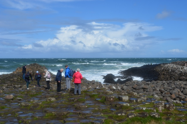 crowds of people visit the giant's causeway - Tips for Exploring the Giant's Causeway in Northern Ireland
