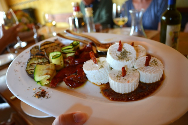 a plate of delicious antipasto at podere il casale - A Day Trip to Tuscany with Walks of Italy