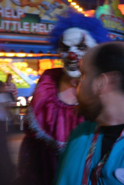 clown chasing you with a chainsaw at Universal - Halloween Horror Nights at Universal Orlando Resorts