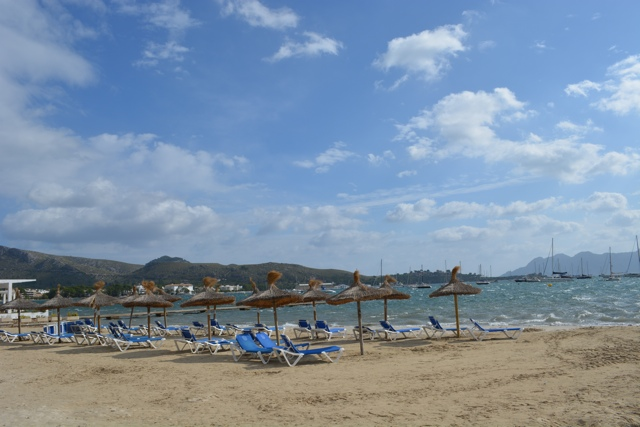 a windy day at the beach in Port de Pollenca, Majorca - Staying in a Luxury Villa with Travelopo in Mallorca, Spain