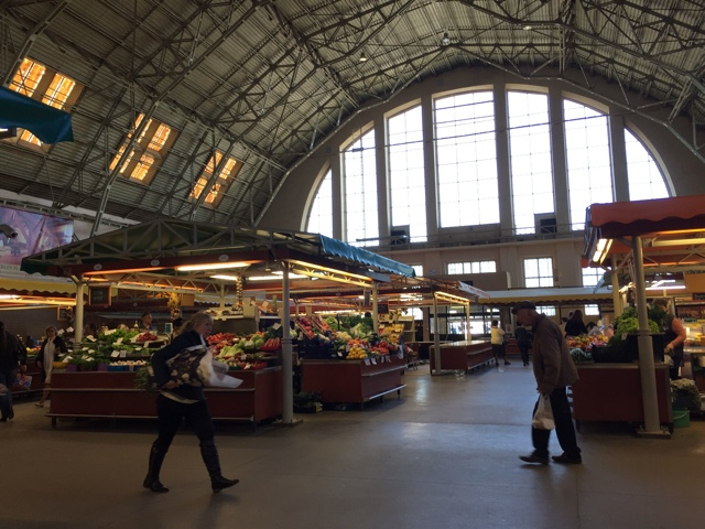 inside the fruit and vegetable hanger at the central riga market - Best Tips for Visiting Riga, Latvia #video