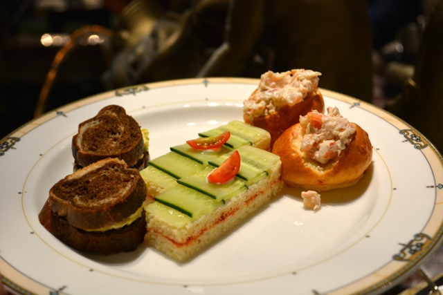 egg salad, cucumber and lobster roll sandwiches at afternoon tea in the Palm Court - Afternoon Tea at The Drake Hotel in Chicago