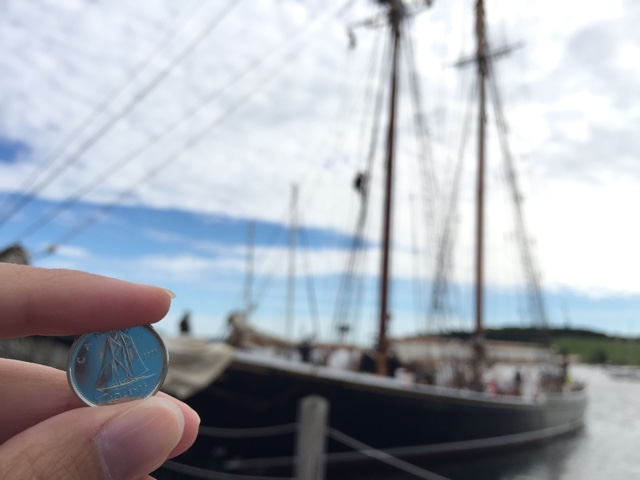 The Bluenose II on the Canadian dime with the Blunose 2 in the background - Lunenburg, Nova Scotia Best Things to See and Do