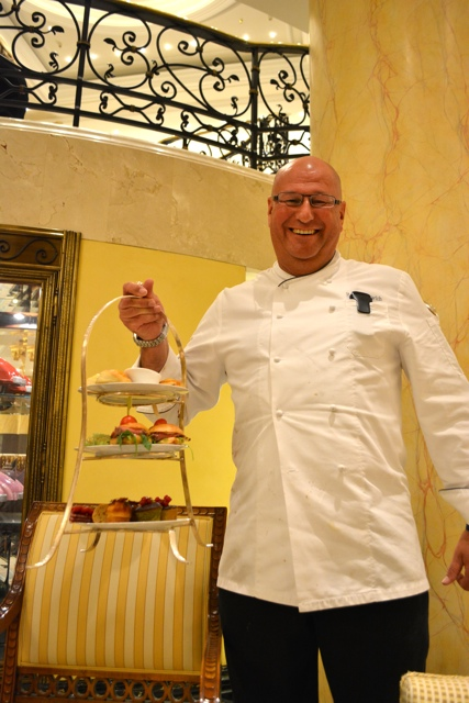 chef delivers afternon tea sandwiches and desserts - Afternoon Tea at The Ritz-Carlton, Berlin