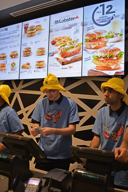 McDonald's employees wearing sou'wester fishermans hats and lobster tshirts selling the McLobster - What is the McDonald's McLobster?